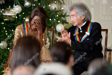 Cicely Tyson, Seiji Ozawa 2015 Kennedy Center Honors Honoree actress Cicely Tyson covers his face as fellow honoree conductor Seiji Ozawa, right, applauds for her on stage during a reception for them in the East Room of the White House, in Washington. The 2015 Kennedy Center Honors Honorees are singer-songwriter Carole King, filmmaker George Lucas, actress and singer Rita Moreno, conductor Seiji Ozawa, and actress Cicely Tyson