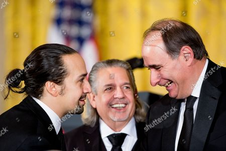 """Lin-Manuel Miranda, Luis A. Miranda, Jr., David Axelrod Broadway musical """"Hamilton"""" creator Lin-Manuel Miranda, left, and his father Luis A. Miranda, Jr., center, speak with former presidential advisor David Axelrod, right, before the 2015 Kennedy Center Honors reception in the East Room of the White House, in Washington. The 2015 Kennedy Center Honors Honorees are singer-songwriter Carole King, filmmaker George Lucas, actress and singer Rita Moreno, conductor Seiji Ozawa, and actress Cicely Tyson"""