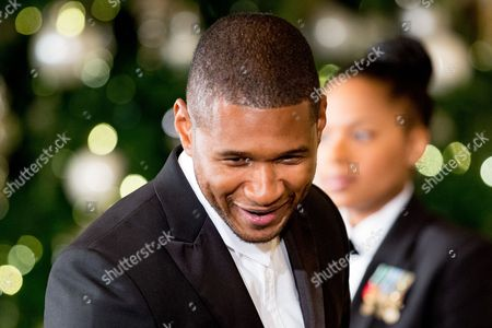 Usher Performer Usher arrives at the 2015 Kennedy Center Honors reception in the East Room of the White House, in Washington. The 2015 Kennedy Center Honors Honorees are singer-songwriter Carole King, filmmaker George Lucas, actress and singer Rita Moreno, conductor Seiji Ozawa, and actress Cicely Tyson
