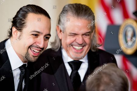 """Lin-Manuel Miranda, Luis A. Miranda, Jr Broadway musical """"Hamilton"""" creator Lin-Manuel Miranda, left, and his father Luis A. Miranda, Jr., right, are seen at the 2015 Kennedy Center Honors reception in the East Room of the White House, in Washington. The 2015 Kennedy Center Honors Honorees are singer-songwriter Carole King, filmmaker George Lucas, actress and singer Rita Moreno, conductor Seiji Ozawa, and actress Cicely Tyson"""