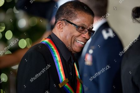 Herbie Hancock Musician Herbie Hancock arrives at the 2015 Kennedy Center Honors reception in the East Room of the White House, in Washington. The 2015 Kennedy Center Honors Honorees are singer-songwriter Carole King, filmmaker George Lucas, actress and singer Rita Moreno, conductor Seiji Ozawa, and actress Cicely Tyson