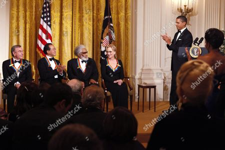 Barack Obama, Michelle Obama, Neil Diamond, Yo-Yo Ma, Sonny Rollins, Meryl Streep President Barack Obama, right, and first lady Michelle Obama, seen standing in the audience at right, applaud the recipients of the 2011 Kennedy Center Honors, from left, singer and songwriter Neil Diamond, cellist Yo-Yo Ma, saxophonist and composer Sonny Rollins, and actress Meryl Streep, during a reception in honor of the recipients in the East Room of the White House, in Washington, on . Not pictured is honoree and singer Barbara Cook