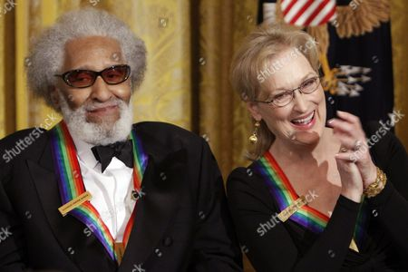 Stock Photo of Sonny Rollins, Meryl Streep 2011 Kennedy Center Honors recipient, saxophonist and composer Sonny Rollins, left, sits next to fellow honoree, actress Meryl Streep, as she reacts to comments from President Barack Obama, not pictured, during a reception for the recipients of the 2011 Kennedy Center Honors in the East Room of the White House, in Washington, on