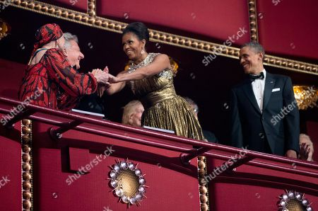 Stock Image of Barack Obama, Dustin Hoffman, Natalia Makarova First lady Michelle Obama, center, accompanying her husband President Barack Obama, right, greets, 2012 Kennedy Center Honors recipients, ballerina Natalia Makarova and actor and director Dustin Hoffman, during the Kennedy Center Honors Gala at the Kennedy Center in Washington
