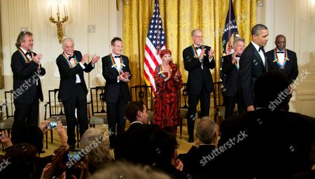 Stock Photo of Barack Obama, Buddy Guy, Dustin Hoffman, David Letterman, Natalia Makarova, John Paul Jones, Jimmy Page, Robert Plant President Barack Obama is applauded by the 2012 Kennedy Center Honors recipients, from left, rock band Led Zeppelin singer Robert Plant, guitarist Jimmy Page, and keyboardist/bassist John Paul Jones, ballerina Natalia Makarova, comedian and television host David Letterman, actor and director Dustin Hoffman and bluesman Buddy Guy, at the conclusion of a reception hosted by President Barack Obama and first lady Michelle Obama for the honorees in the East Room of the White House in Washington, . While Led Zeppelin is being honored as a band, surviving members John Paul Jones, Jimmy Page, and Robert Plant, each received the Kennedy Center Honors