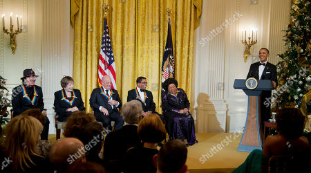 Barack Obama, Michelle Obama, Martina Arroyo, Herbie Hancock, Billy Joel, Shirley MacLaine, Carlos Santana President Barack Obama, right, and the 2013 Kennedy Center Honors recipients, from left; Carlos Santana, Shirley MacLaine, Billy Joel and Herbie Hancock, Martina Arroyo, laugh during a reception honoring the 2013 Kennedy Center Honors recipients, in the East Room of the White House in Washington