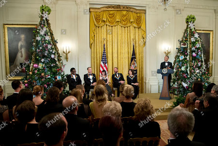 Stock Picture of Barack Obama, Al Green, Tom Hanks, Patricia McBride, Sting, Lily Tomlin The 2014 Kennedy Center Honors Honorees, singer Al Green, from left, actor and filmmaker Tom Hanks, ballerina Patricia McBride, singer-songwriter Sting, and comedienne Lily Tomlin, are introduced by President Barack Obama speaks, during a reception in the East Room of the White House in Washington, hosted by the president and first lady Michelle Obama, honoring the the Kennedy Center Honorees