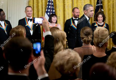 Barack Obama, Al Green, Tom Hanks, Patricia McBride, Sting, Lily Tomlin President Barack Obama, walks on the stage during a reception honoring the 2014 Kennedy Center Honors Honorees, singer Al Green, from left, actor and filmmaker Tom Hanks, ballerina Patricia McBride, singer-songwriter Sting, and comedienne Lily Tomlin, in the East Room of the White House in Washington, hosted by the president and first lady Michelle Obama