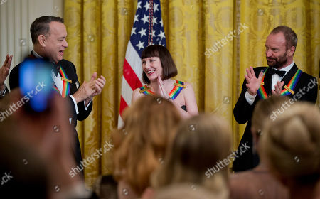 Tom Hanks, Patricia McBride, Sting The 2014 Kennedy Center Honors Honorees actor and filmmaker Tom Hanks, from left, ballerina Patricia McBride, and singer-songwriter Sting, give their applause during a reception in the East Room of the White House in Washington, hosted by President Barack Obama and first lady Michelle Obama, honoring the the Kennedy Center Honorees