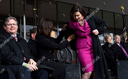 Michelle Obama, Victoria Reggie Kennedy, Ted Kennedy, Jr First lady Michelle Obama helps Victoria Reggie Kennedy with her coat during the dedication of the Edward M. Kennedy Institute for the United States Senate, in Boston. Connecticut State Seb.Ted Kennedy, Jr. is at left. The $79 million Edward M. Kennedy Institute for the United States Senate dedication is a politically star-studded event attended by President Barack Obama, Vice President Joe Biden and past and present senators of both parties. It sits next to the presidential library of Kennedy's brother, John F. Kennedy