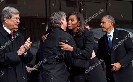 Barack Obama, Michelle Obama, Trent Lott, Ted Kennedy, Jr First lady Michelle Obama hugs Connecticut State Sen. Ted Kennedy, Jr., as former Senate Majority Leader Trent Lott of Miss., left, and President Barack Obama, watch, before the dedication of the Edward M. Kennedy Institute for the United States Senate, in Boston. The $79 million Edward M. Kennedy Institute for the United States Senate dedication is a politically star-studded event attended by President Barack Obama, Vice President Joe Biden and past and present senators of both parties. It sits next to the presidential library of Kennedy's brother, John F. Kennedy