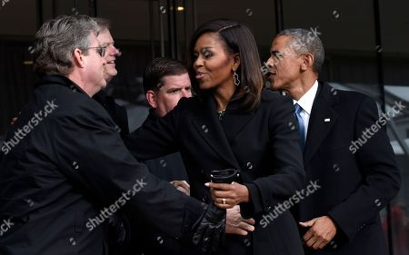 Barack Obama, Michelle Obama, Marty Walsh, Charlie Baker, Ted Kennedy Jr President Barack Obama and first lady Michelle Obama greet Connecticut State Sen. Ted Kennedy, Jr., left, Massachusetts Gov. Charlie Baker, second from left, and Boston Mayor Marty Walsh, center, at the dedication of the Edward M. Kennedy Institute for the United States Senate, in Boston. The $79 million Edward M. Kennedy Institute for the United States Senate dedication is a politically star-studded event attended by President Barack Obama, Vice President Joe Biden and past and present senators of both parties. It sits next to the presidential library of Kennedy's brother, John F. Kennedy