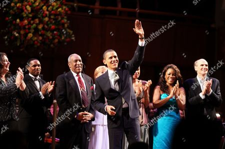 Barack Obama, Bill Cosby, Lizz Wright, Denyce Graves, James Taylor President Barack Obama, center, waves to Sen. Edward M. Kennedy, D-Mass., after joining various entertainers in singing happy birthday during a musical birthday salute to Kennedy, at The John F. Kennedy Center for the Performing Arts in Washington. Joining Obama on stage is Bill Cosby, Lizz Wright, Denyce Graves and James Taylor. The others are unidentified