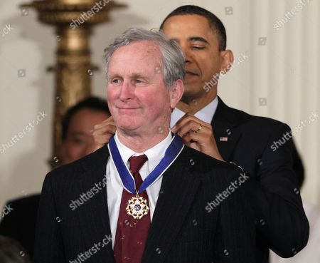 Stock Image of Barack Obama, John H. Adams President Barack Obama presents a 2010 Presidential Medal of Freedom to John H. Adams, co-founder of the Natural Resources Defense Council, during a ceremony in the East Room of the White House in Washington