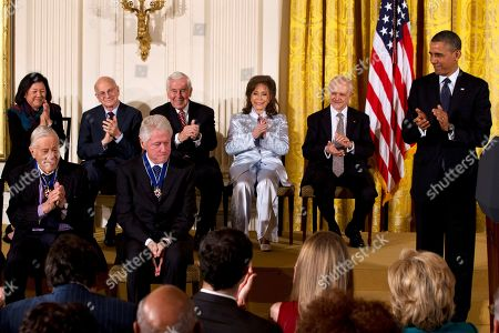 Barack Obama, Ben Bradlee, Bill Clinton, Daniel Kahneman, Richard Lugar, Loretta Lynn, Mario Molina, Irene Hirano President Barack Obama, Ben Bradlee, former executive editor of The Washington Post, front row left, and others, applaud former President Bill Clinton, in the East Room of the White House in Washington, during Presidential Medal of Freedom award ceremony. Back row, from left are, Irene Hirano, who accepted a posthumous award for her husband the late Hawaii Sen. Daniel Inouye, D-Hawaii, psychologist Daniel Kahneman, former Indiana Sen. Richard Lugar country music legend Loretta Lynn, and chemist Mario Molina