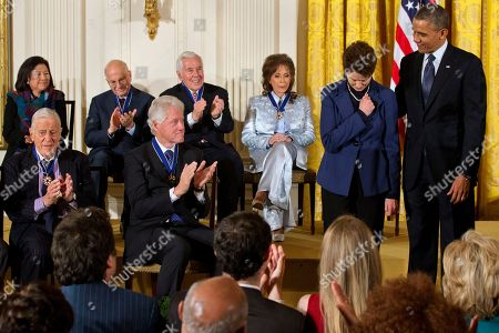 Barack Obama, Tam O'Shaughnessy, Ben Bradlee, Bill Clinton, Irene Hirano, Daniel Inouye, Daniel Kahneman, Richard Lugar, Loretta Lynn, Mario Molina President Barack Obama, right, awards a posthumous Presidential Medal of Freedom for Sally Ride to Tam O'Shaughnessy, Ride's partner of 27 years, as she bows her head and covers her heart, during a ceremony in the East Room of the White House in Washington. Bottom, from left are, Ben Bradlee, former executive editor of The Washington Post, and former President Bill Clinton, Back row, from left are, Irene Hirano, accepting a posthumous award for her husband, the late Hawaii Sen. Daniel Inouye, psychologist Daniel Kahneman, former Indiana Sen. Richard Lugar and country music legend Loretta Lynn