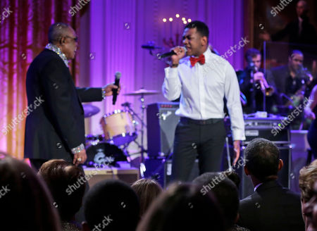 """Barack Obama, Sam Moore, Joshua Ledet President Barack Obama, right seated, watches as singers Sam Moore, left, and Joshua Ledet, right, perform on stage during the """"In Performance at the White House"""" in the East Room of the White House in Washington, a program for a celebration of Memphis Soul Music"""