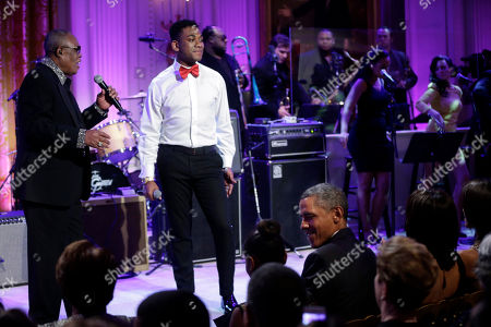 """Barack Obama, Sasha Obama, Sam Moore, Joshua Ledet President Barack Obama, center seated, looks over towards his daughter Sasha, as singers Sam Moore, left, and Joshua Ledet, right, perform on stage during the """"In Performance at the White House"""" in the East Room of the White House in Washington, a program for a celebration of Memphis Soul Music"""