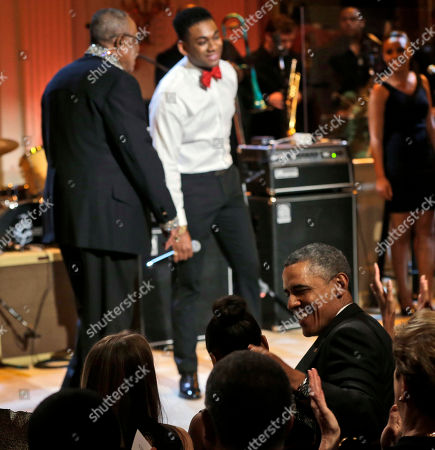 """Barack Obama, Sasha Obama, Sam Moore, Joshua Ledet President Barack Obama, center seated, looks over toward his daughter Sasha, as singers Sam Moore, left, and Joshua Ledet, right, perform on stage during the """"In Performance at the White House"""" in the East Room of the White House in Washington, a program for a celebration of Memphis Soul Music"""