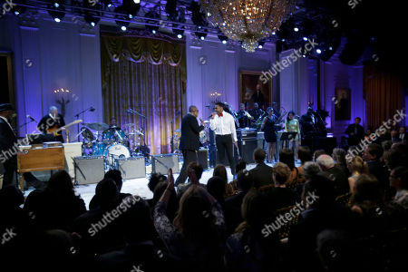 """Barack Obama, Sam Moore, Joshua Ledet President Barack Obama, center seated, watches as singers Sam Moore, left, and Joshua Ledet, right, perform on stage during the """"In Performance at the White House"""" in the East Room of the White House in Washington, a program for a celebration of Memphis Soul Music"""