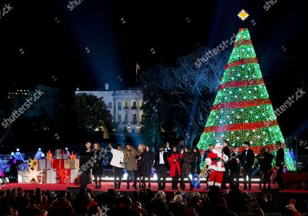 Tom Hanks, Rita Wilson, Patti LaBelle, Fifth Harmony, Chely Wright, NE-YO, Nico & Vinz, The Tenors Performers gather on stage from left, Tom Hanks, Rita Wilson, Patti LaBelle, Fifth Harmony, Chely Wright, NE-YO, Nico & Vinz, The Tenors and Santa, during the finale of the National Christmas Tree lighting ceremony at the Ellipse near the White House in Washington