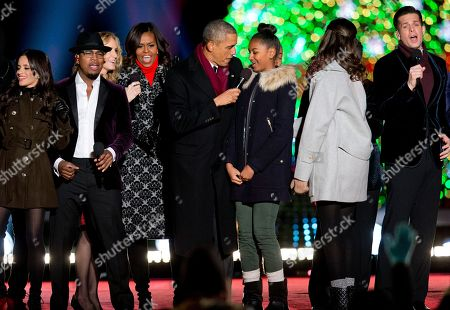 Barack Obama, Michelle Obama, Sasha Obama, Malia Obama, NE-YO, The Tenors, Chely Wright, Fifth Harmony President Barack Obama holds the microphone for his daughter Sasha Obama as they sing on stage during the National Christmas Tree lighting ceremony at the Ellipse near the White House in Washington, . Also on stage are from left, a member of Fifth Harmony, NE-YO, Chely Wright, first lady Michelle Obama, Malia Obama, and a member of The Tenors