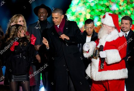 Barack Obama, Nico & Vinz, The Tenors, Fifth Harmony, Chely Wright President Barack Obama dances on stage with Santa, members of Fifth Harmony, left, Chely Wright, Nico & Vinz and a member of The Tenors, behind, during the National Christmas Tree lighting ceremony at the Ellipse near the White House in Washington
