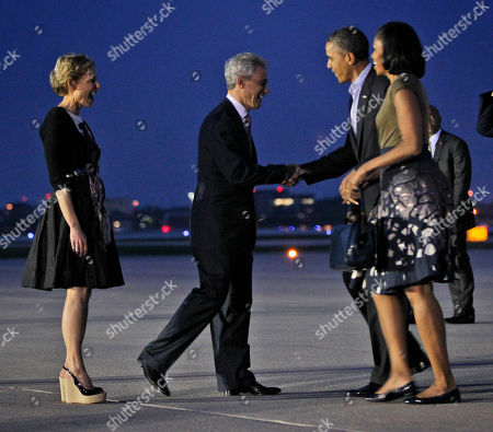 Barack Obama, Michelle Obama, Amy Rule, Rahm Emanuel President Barack Obama and first lady Michelle Obama are greeted by Chicago Mayor Rahm Emanuel, center, and wife Amy Rule, during their arrival at O'Hare International airport in Chicago, Saturday, May, 19, 2012. Obama traveled to Chicago to host the two-day NATO summit