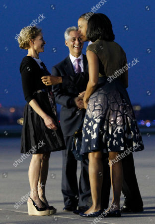 Barack Obama, Michelle Obama, Amy Rule, Rahm Emanuel President Barack Obama and first lady Michelle Obama are greeted by Chicago Mayor Rahm Emanuel, center, and his wife Amy Rule, during their arrival at O'Hare International airport in Chicago, Saturday, May, 19, 2012. Obama traveled to Chicago to host the two-day NATO summit