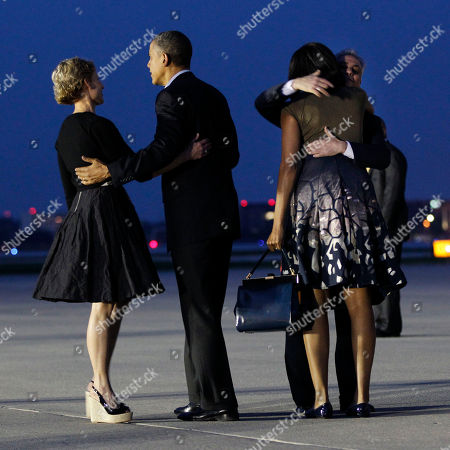 Barack Obama, Michelle Obama, Amy Rule, Rahm Emanuel President Barack Obama, center, and first lady Michelle Obama are greeted by Chicago Mayor Rahm Emanuel and wife Amy Rule, during their arrival at O'Hare International airport in Chicago, Saturday, May, 19, 2012. Obama traveled to Chicago to host the two-day NATO summit