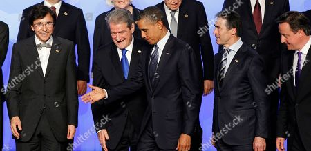 Stock Picture of Barack Obama, Anders Fogh Rasmussen, Bamir Topi, British Prime Minister David Cameron, Elio Di Rupo President Barack Obama, center, walks off stage after posing for the NATO family photo, in Chicago. Walking with Obama are from left to right, Belgium Prime Minister Elio Di Rupo, Albanian President Bamir Topi, NATO Secretary General Anders Fogh Rasmussen, and British Prime Minister David Cameron