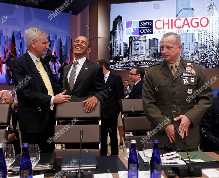 Barack Obama, Carl Bildt, John R. Allen Swedish Foreign Minister Carl Bildt, left, shares a laugh with President Barack Obama, center, before the start of the International Security Assistance Force (ISAF) meeting on Afghanistan at the NATO Summit, in Chicago, . At right is Gen. John R. Allen, Commander of the International Security Assistance Force