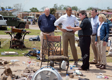 Stock Photo of Barack Obama, Glenn Lewis, Tom Cole, Mary Fallin President Barack Obama tours the destroyed area surrounding the Plaza Towers Elementary School with Moore, Okla. Mayor Glenn Lewis, third from left, FEMA administrator W. Craig Fugate, left, Rep. Tom Cole, R-Okla., fourth from left, and Oklahoma Gov. Mary Fallin, right, in Moore, Okla., caused by tornado and severe weather last week