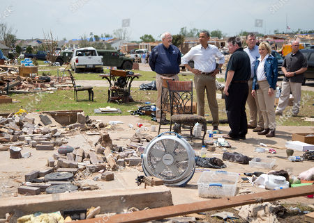 Barack Obama, Glenn Lewis, Tom Cole, Mary Fallin President Barack Obama tours the destroyed area surrounding the Plaza Towers Elementary School with Moore, Okla. Mayor Glenn Lewis, third from left, FEMA administrator W. Craig Fugate, left, Rep. Tom Cole, R-Okla., fourth from left, and Oklahoma Gov. Mary Fallin, right, in Moore, Okla., caused by tornado and severe weather last week