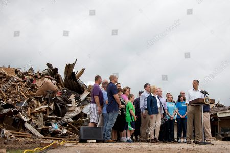 Barack Obama, Glenn Lewis President Barack Obama, surrounded by school and state officials, speaks to the media among the rubble of Plaza Towers Elementary School, in Moore, Okla., caused by tornado and severe weather last week