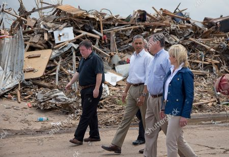 Barack Obama, Glenn Lewis, Tom Cole, Mary Fallin President Barack Obama tours the devastated Plaza Towers Elementary School and surrounding area with Moore, Okla. Mayor Glenn Lewis, left, Oklahoma Gov. Mary Fallin, right, and Rep. Tom Cole, R-Okla., second from right, in Moore, Okla., caused by tornado and severe weather last week