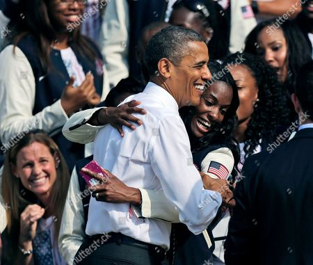 Barack Obama, DeeDee Trotter President Barack Obama is hugged by DeeDee Trotter, a member of the US Olympics relay team during a ceremony on the South Lawn of the White House in Washington, where President Barack Obama welcomed the 2012 U.S. Olympic and Paralympic teams