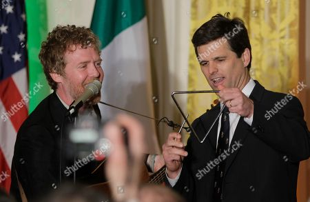 Glen Hansard, Timothy Shriver Irish singer Glen Hansard, left, performs as Timothy Shriver, chairman and chief executive officer of the Special Olympics joins him onstage with a triangle before President Barack Obama and Prime Minister Enda Kenny of Ireland speak a St. Patrick's Day celebration in the East Room of the White House in Washington