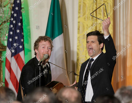 Glen Hansard, Timothy Shriver Irish singer Glen Hansard, left, performs as Timothy Shriver, chairman and chief executive officer of the Special Olympics joins him onstage before President Barack Obama and Prime Minister Enda Kenny of Ireland speak a St. Patrick's Day celebration in the East Room of the White House in Washington