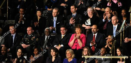 Mark Todd, Kimberly Munley, Michelle Obama, Rebecca Knerr, Jill Biden, Julia Frost, Li Boynton, Tina Dixon Front row, from left are, Mark Todd of Killeen, Texas, Kimberly Munley of Killeen, Texas, first lady Michelle Obama, Rebecca Knerr of Chantilly, Va., Jill Biden, wife of Vice President Joe Biden, Julia Frost of Jacksonville, N.C., Clayton Armstrong of Washington, and Li Boynton of Bellaire, Texas, are seen at the State of the Union address on Capitol Hill in Washington, . Deborah Powell of Hugo, Okla., is in the second row third from right, and Tina Dixon of Allentown, Pa., is in the third row, third from right