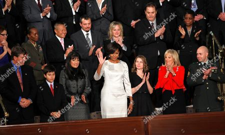 Stock Image of Michelle Obama First lady Michelle Obama waves on Capitol Hill in Washington, prior to the start of President Barack Obama's State of the Union address. Also sitting in the first lady's box from front left are John Green, Dallas Green, Roxanna Green, Obama, Brianna Mast, Jill Biden and Sgt. Brian Mast. Second row from left are Kathy Proctor, Sgt. Nicole Mohabir, Dr. Peter Rhee, Brandon Fisher, Julie fisher, Gary Allen and Ursula M. Burns