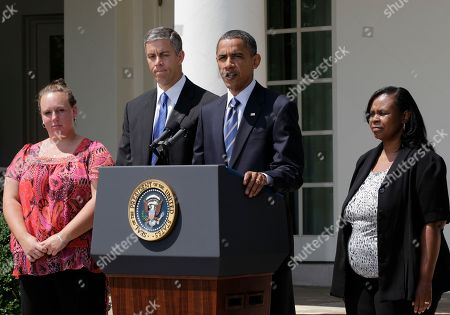 Barack Obama, Arne Duncan, Shannon Lewis, Rachel Martin President Barack Obama, accompanied by teachers, and Education Secretary Arne Duncan, speaks in the Rose Garden of the White House in Washington, to urge the House to pass legislation that could help keep 160,000 educators on the job. From left are: Shannon Lewis, of Romney, W. Va., who was a special education instructor who lost her job in June when her position was cut due to lack of funding, Duncan, the president, and Rachel Martin who taught kindergarten in Richton Park, Ill. until she was laid off in March