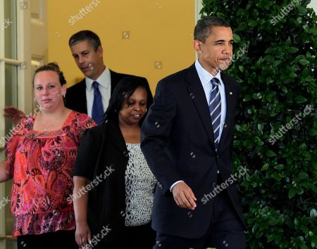 Barack Obama, Arne Duncan, Shannon Lewis, Rachel Martin President Barack Obama, followed by teachers and Education Secretary Arne Duncan, walks to the Rose Garden of the White House in Washington, to urge the House to pass legislation that could help keep 160,000 educators on the job. From left are: Shannon Lewis, of Romney, W. Va., who was a special education instructor who lost her job in June when her position was cut due to lack of funding, Duncan, and Rachel Martin who taught kindergarten in Richton Park, Ill. until she was laid off in March, and the president