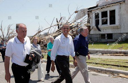Barack Obama, Jay Nixon, Mike Woolston President Barack Obama views damage from the tornado that devastated Joplin, Mo., . He is joined by Joplin Mayor Mike Woolston, left, and Missouri Gov. Jay Nixon, right