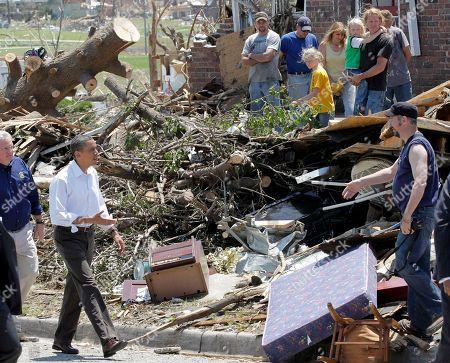 Barack Obama, Jay Nixon President Barack Obama, followed by Missouri Gov. Jay Nixon, views damage and greets residents from the tornado that devastated Joplin, Mo