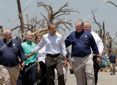 Barack Obama, William Craig Fugate, Jay Nixon President Barack Obama walks with FEMA Director William Craig Fugate, left, and Missouri Gov. Jay Nixon, right, as they view damage from the tornado that devastated Joplin, Mo