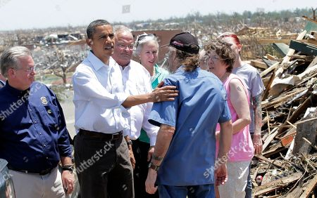 Barack Obama, Jay Nixon, Billy Long President Barack Obama meets with victim as he views damage from the tornado that devastated Joplin, Mo., . He is joined by Missouri Gov. Jay Nixon, left, and Rep. Billy Long, R-Mo., third from left