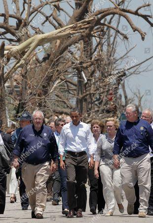 Barack Obama, William Craig Fugatem Jay Nixon President Barack Obama walks with FEMA Director William Craig Fugate, left, and Missouri Gov. Jay Nixon, right, as they view damage from the tornado that devastated Joplin, Mo