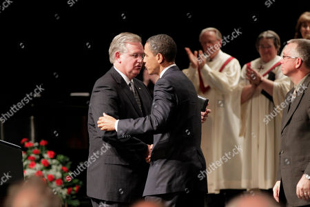 Barack Obama, Jay Nixon President Barack Obama exchanges a greeting with Missouri Gov. Jay Nixon as he participates in a memorial service at Missouri Southern State University for the victims of the tornado that devastated Joplin, Mo
