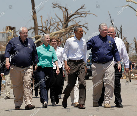Barack Obama President Barack Obama views damage from the tornado that devastated Joplin, Mo., . Obama is joined by Missouri Gov. Jay Nixon, second from right, and FEMA Director William Fugate, left